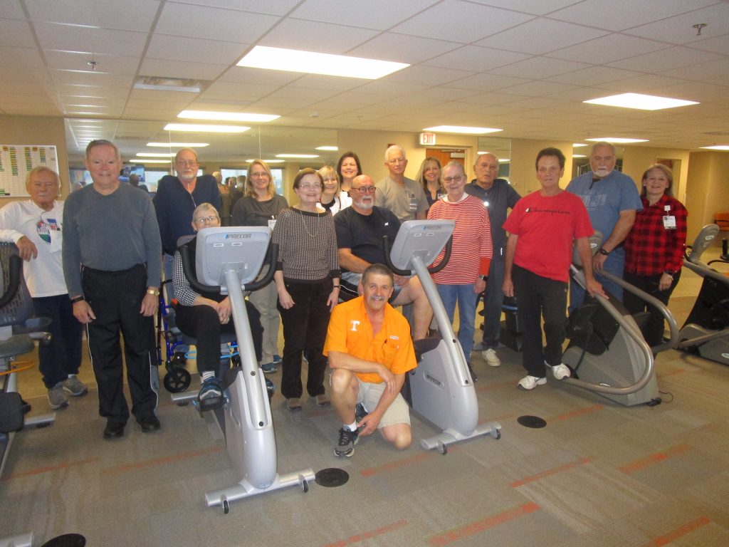 Group of FSRMC's cardiac rehab program attendees pose with workout equipment