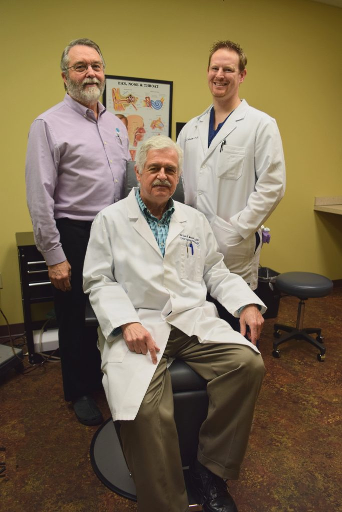 Dr. Leonard Brown, left, with fellow otolarynologists Dr. William H. Merwin (seated) and Dr. Drue Manning in their Farragut clinic.