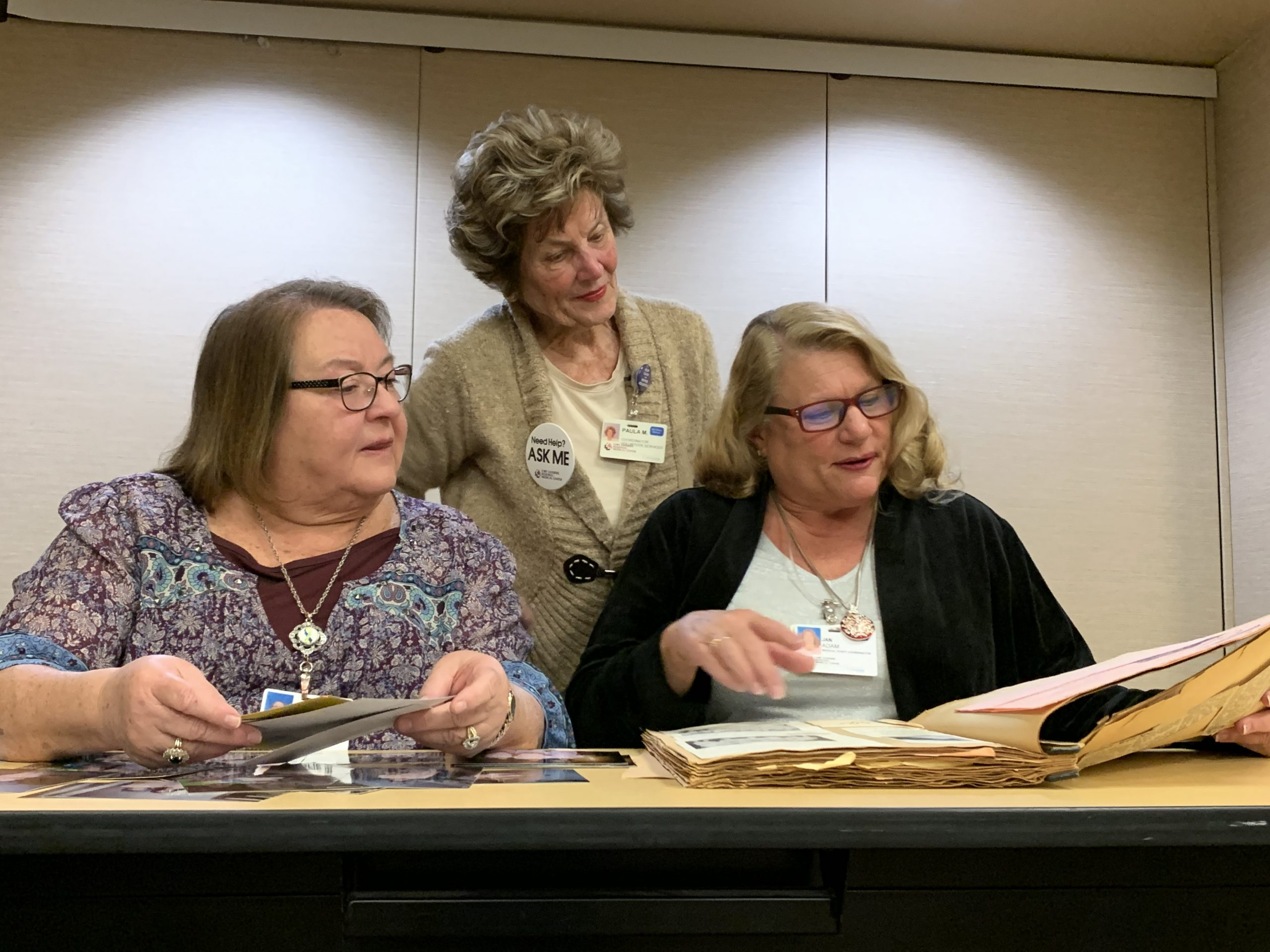 Leslie Mellon, Jan Adam and Paula Minhinnet review FSRMC candy striper history