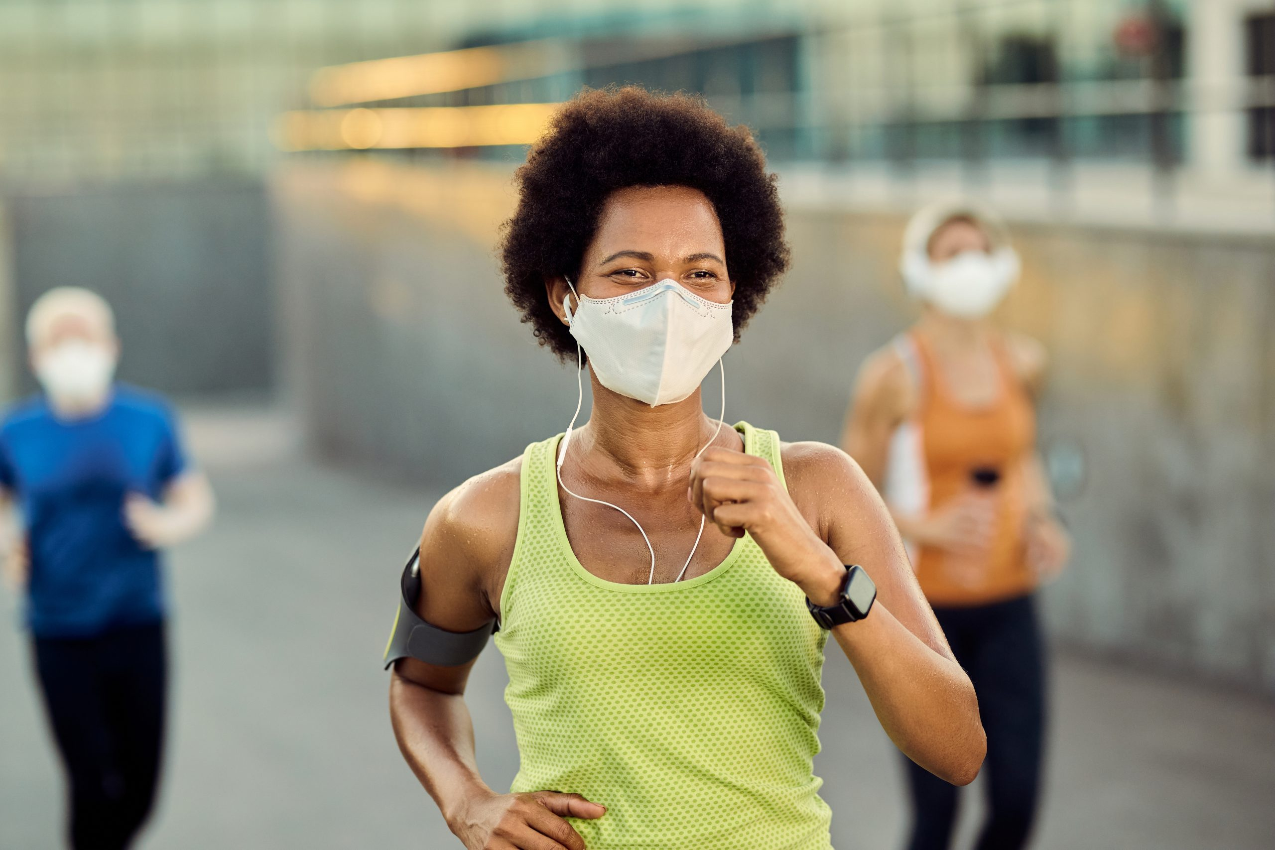 woman running with mask on